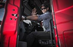 离开仓库的卡车司机 图库摄影