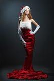 秀丽圣诞节礼服纵向红色妇女 免版税库存照片