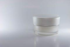 秀丽奶油色包装的容器白色颜色 免版税库存图片
