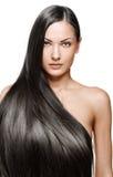 秀丽妇女。 长的头发 免版税库存照片