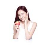 秀丽妇女用苹果 库存照片