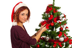 秀丽妇女装饰圣诞树 图库摄影