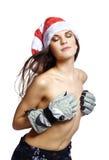 秀丽帽子圣诞老人露胸部的妇女年轻&# 库存图片