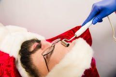 秀丽温泉的圣诞老人 免版税库存照片
