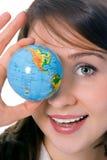 秀丽眼睛前面女孩地球暂挂yung 图库摄影