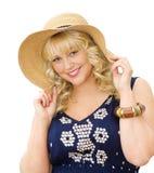 秀丽逗人喜爱女孩帽子秸杆夏天佩带 免版税库存照片