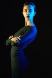 秀丽黑色礼服性感的妇女 库存照片