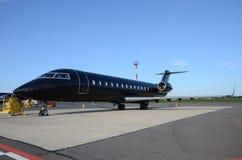 黑私人喷气式飞机 免版税图库摄影
