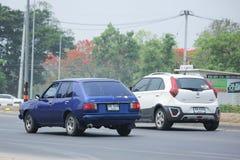 私有老汽车,马自达323 免版税图库摄影