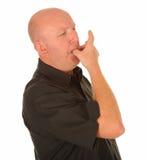 秃头人吹口哨 库存照片