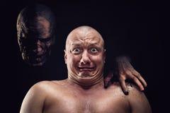 秃头害怕的人画象  免版税库存照片