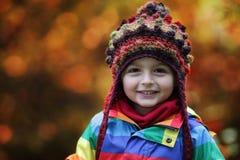 秋天公园设置的男孩 免版税图库摄影