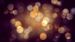 秋天夜的金黄bokeh作用 温暖的被弄脏的sparcles背景影响 股票录像