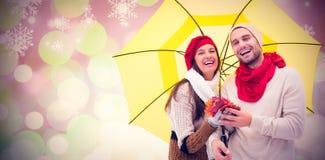秋天夫妇的综合图象拿着伞的 免版税库存照片
