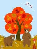 秋天树和两头熊 库存图片
