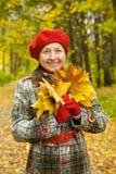 秋天纵向前辈妇女 库存图片