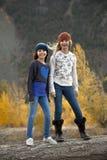 秋天设置的两个姐妹 免版税库存图片
