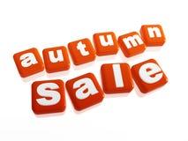 秋天销售额-在橙色多维数据集的文本 库存照片