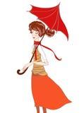 秋天颜色的女孩在围巾和一把伞在雨中 图库摄影