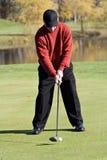 秋天高尔夫球运动员 图库摄影