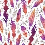 种族在boho样式的羽毛无缝的样式 免版税库存图片