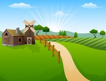 种田与棚子和红色风车的风景在早晨 皇族释放例证