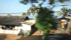 科伦坡,斯里兰卡- 2014年2月:科伦坡从通过火车的海边郊区看法  斯里兰卡的铁路运输数百万 影视素材