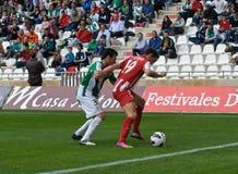 科多巴,西班牙- 3月17 : 卡洛斯Calvo行动的Sobrado R (19)在比赛同盟科多巴期间(W)对阿尔梅里雅(r) (4-1) 免版税库存图片