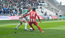 科多巴,西班牙- 3月17 : Iago Falquï在行动的¿ ½ R (14)在比赛同盟科多巴期间(W)对阿尔梅里雅(r) (4-1) 库存照片