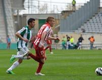 科多巴,西班牙- 3月17 :Andri�n哈维尔行动的Gunino R (21)在比赛同盟科多巴期间(W)对阿尔梅里雅(r) (4-1) 图库摄影