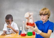 科学孩子有空白的灰色背景 库存图片
