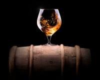 科涅克白兰地或白兰地酒在黑色 免版税图库摄影