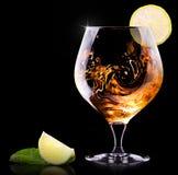 科涅克白兰地或白兰地酒在黑色 免版税库存图片