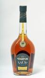 科涅克白兰地Tavria在白色背景的瓶特写镜头 免版税库存照片