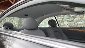 科鲁Napoca/罗马尼亚- 2016年9月19日:奔驰车W209-年2005年,高雅设备,黑金属油漆,照相讲席会C 库存图片