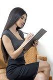 秘书繁忙的采取的笔记在会议上 免版税库存照片
