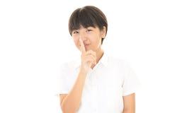 秘密姿态的女孩  免版税图库摄影