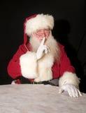 秘密的圣诞老人 库存照片