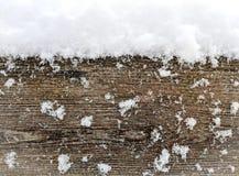 积雪的篱芭板 库存图片