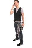 称的男孩移动电话英俊的年轻人 免版税库存图片