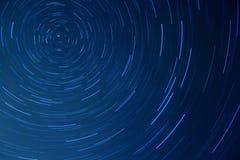 移动在晚上的星形 库存图片