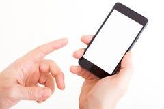 移动巧妙的电话在手中 免版税库存照片