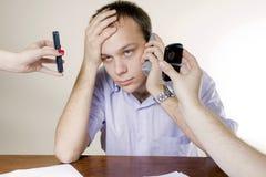 移动电话供以人员三个年轻人 免版税库存图片