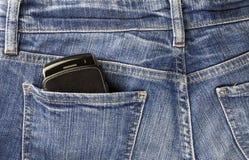 移动电话和牛仔裤 免版税库存图片