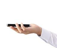 移动电话在手中 库存图片