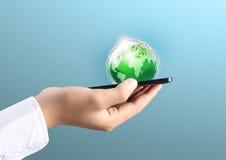 移动电话在手中 免版税库存照片