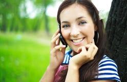移动电话女孩联系 免版税图库摄影
