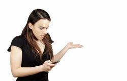 移动电话她查找使妇女惊奇 库存图片
