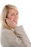 移动电话微笑的妇女 图库摄影