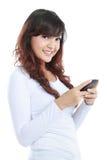 移动电话微笑的texting的妇女 免版税库存图片